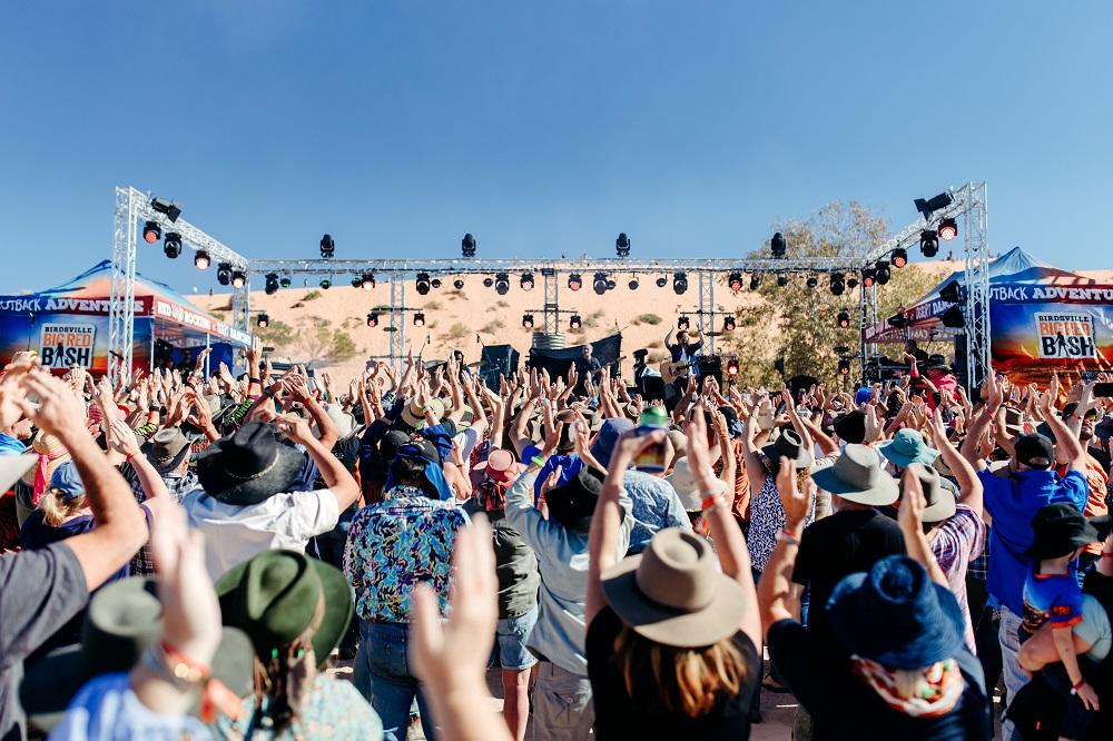 Media Mortar_Birdsville Big Red Bash hands up_Image by Tourism & Events Queensland