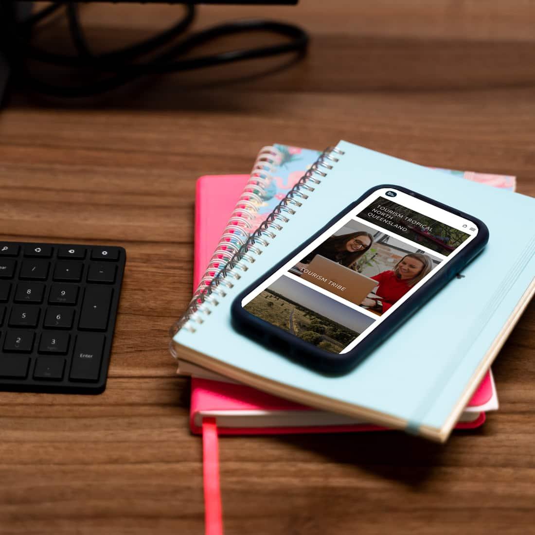 Media Mortar_Instagram Stories_Open phone on notebooks